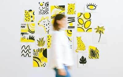 woman walking against art background